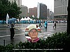 Protesters in Seoul and inset: goodwill volunteer
